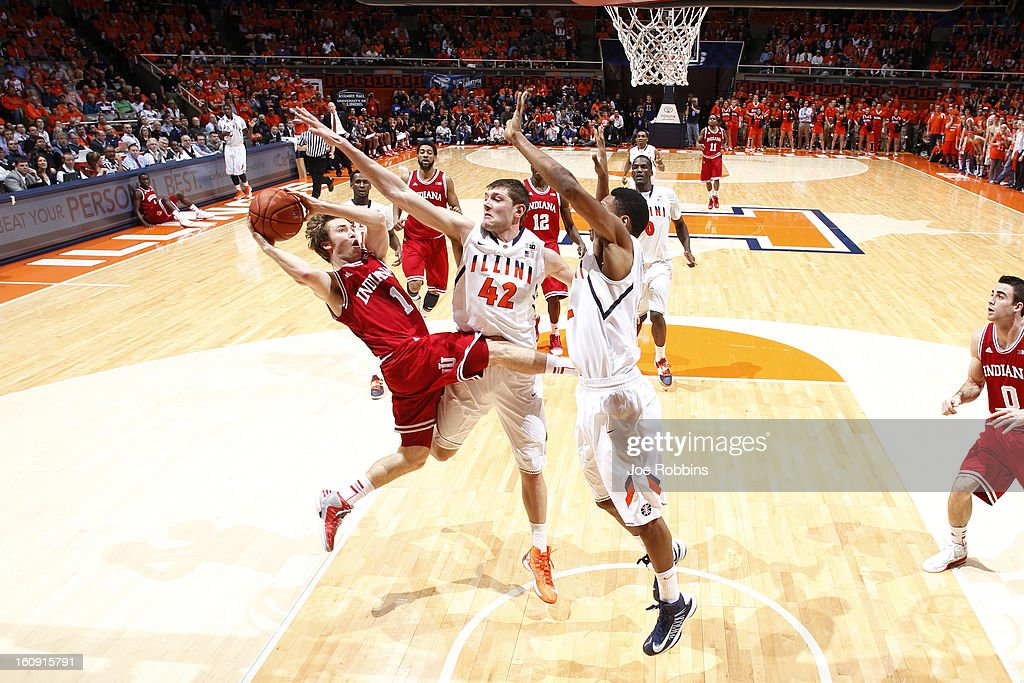 Tyler Griffey #42 and Joseph Bertrand #2 of the Illinois Fighting Illini defend against Jordan Hulls #1 of the Indiana Hoosiers during the game at Assembly Hall on February 7, 2013 in Champaign, Illinois. Illinois defeated No. 1 ranked Indiana 74-72.