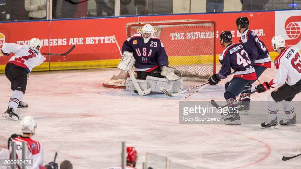 Tyler Gron of Team Canada shot on goal is denied by Joseph Fallon of Team USA during the Melbourne Game of the Ice Hockey Classic on June 24 2017...