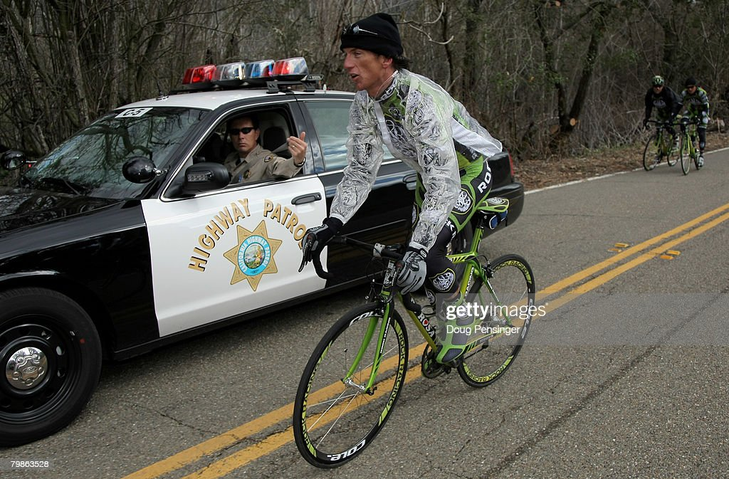 Tyler Hamilton of the USA and riding for Rock Racing is motioned off the course by California Highway Patrol as he and teammates Santiago Botero of...