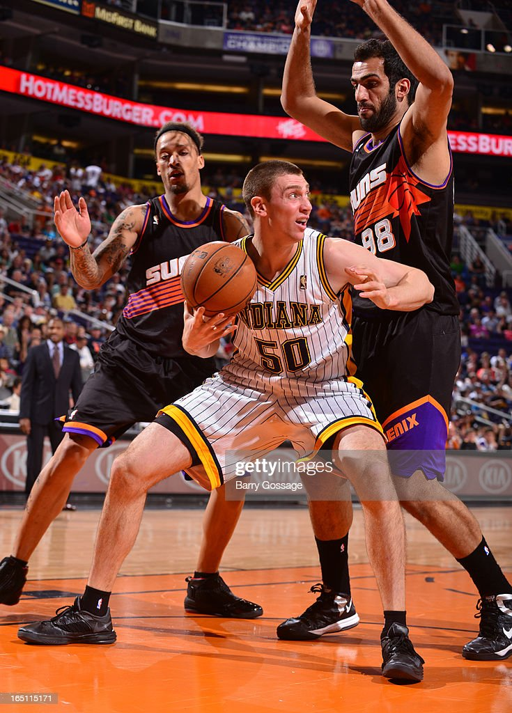 Tyler Hansbrough #50 of the Indian Pacers tries to drive around Michael Beasley #0 and Hamed Haddadi #98 of the Phoenix Suns on March 30, 2013 at U.S. Airways Center in Phoenix, Arizona.