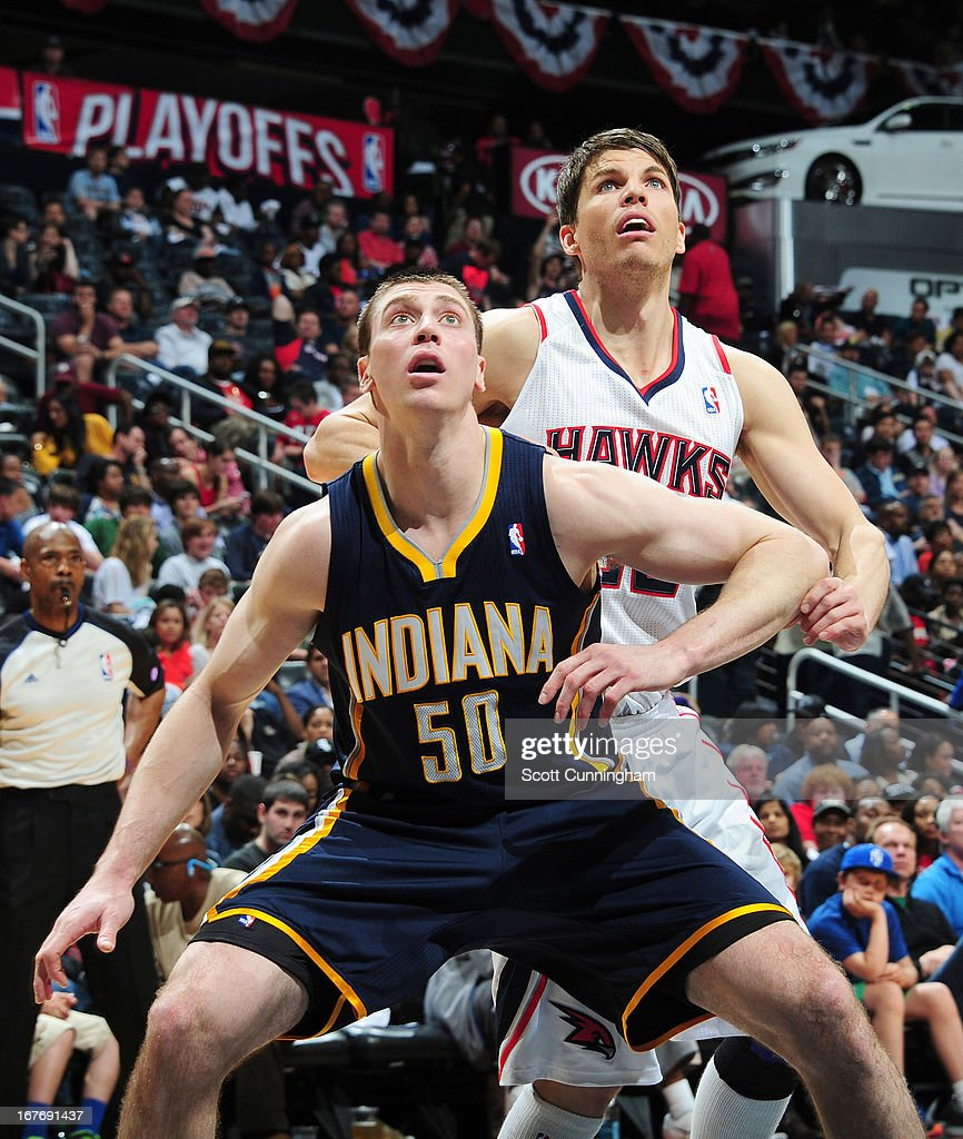 Tyler Hansbrough #50 of the Indiana Pacers and Kyle Korver #26 of the Atlanta Hawks wait for a rebound during the Game Three of the Eastern Conference Quarterfinals between the Indiana Pacers and the Atlanta Hawks in the 2013 NBA Playoffs on April 27, 2013 at Philips Arena in Atlanta, Georgia.