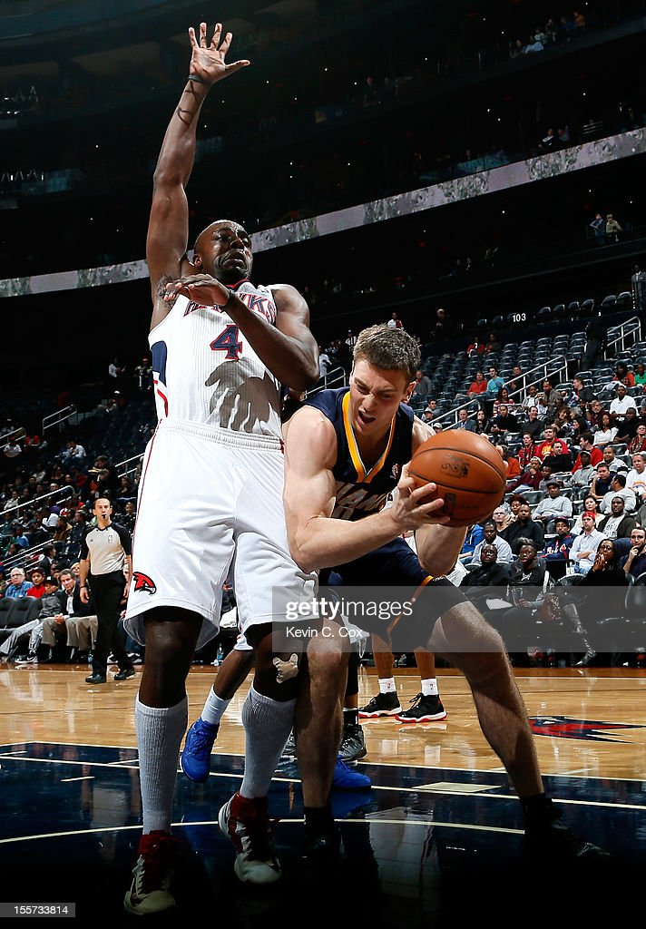 <a gi-track='captionPersonalityLinkClicked' href=/galleries/search?phrase=Tyler+Hansbrough&family=editorial&specificpeople=642794 ng-click='$event.stopPropagation()'>Tyler Hansbrough</a> #50 of the Indiana Pacers attacks the basket against <a gi-track='captionPersonalityLinkClicked' href=/galleries/search?phrase=Anthony+Tolliver&family=editorial&specificpeople=4195496 ng-click='$event.stopPropagation()'>Anthony Tolliver</a> #4 of the Atlanta Hawks at Philips Arena on November 7, 2012 in Atlanta, Georgia.