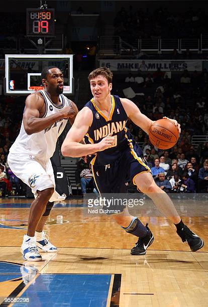 Tyler Hansbrough of the Indiana Pacers drives against Gilbert Arenas of the Washington Wizards during the game on December 12 2009 at the Verizon...