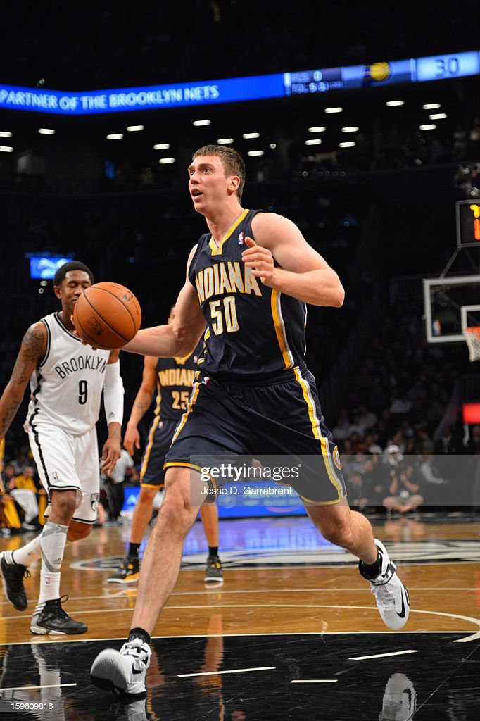 Tyler Hansbrough #50 of the Indiana Pacers drives against the Brooklyn Nets during the game at the Barclays Center on January 13, 2013 in Brooklyn, New York.