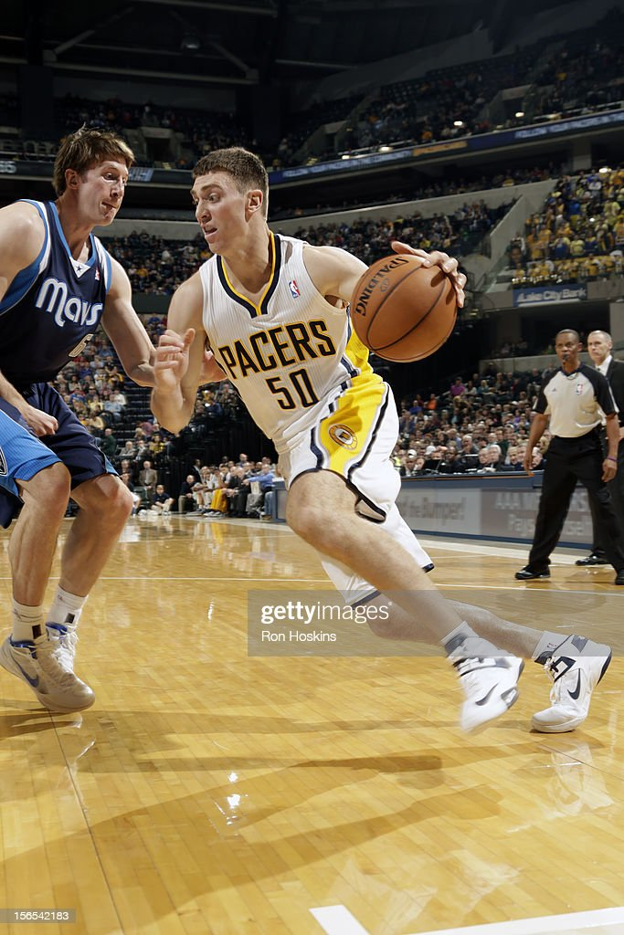 <a gi-track='captionPersonalityLinkClicked' href=/galleries/search?phrase=Tyler+Hansbrough&family=editorial&specificpeople=642794 ng-click='$event.stopPropagation()'>Tyler Hansbrough</a> #50 of the Indiana Pacers drives to the basket against <a gi-track='captionPersonalityLinkClicked' href=/galleries/search?phrase=Troy+Murphy&family=editorial&specificpeople=201794 ng-click='$event.stopPropagation()'>Troy Murphy</a> #6 of the Dallas Mavericks on November 16, 2012 at Bankers Life Fieldhouse in Indianapolis, Indiana.