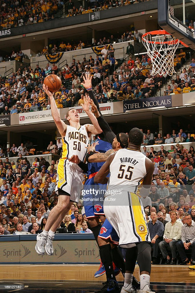 <a gi-track='captionPersonalityLinkClicked' href=/galleries/search?phrase=Tyler+Hansbrough&family=editorial&specificpeople=642794 ng-click='$event.stopPropagation()'>Tyler Hansbrough</a> #50 of the Indiana Pacers drives to the basket against the New York Knicks in Game Four of the Eastern Conference Semifinals during the 2013 NBA Playoffs on May 14, 2013 at Bankers Life Fieldhouse in Indianapolis.