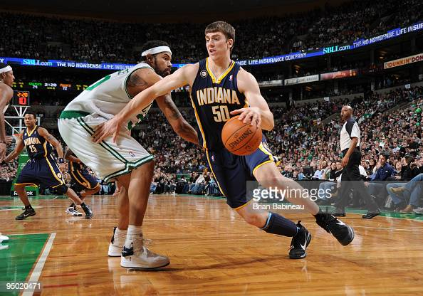 Tyler Hansbrough of the Indiana Pacers drives to the basket against Rasheed Wallace of the Boston Celtics on December 22 2009 at the TD Garden in...