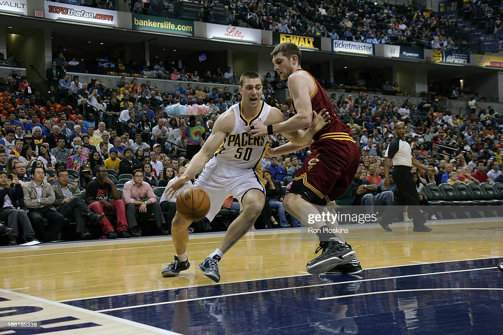 <a gi-track='captionPersonalityLinkClicked' href=/galleries/search?phrase=Tyler+Hansbrough&family=editorial&specificpeople=642794 ng-click='$event.stopPropagation()'>Tyler Hansbrough</a> #50 of the Indiana Pacers drives to the hoop against the Cleveland Cavaliers on April 8, 2013 at Bankers Life Fieldhouse in Indianapolis, Indiana.