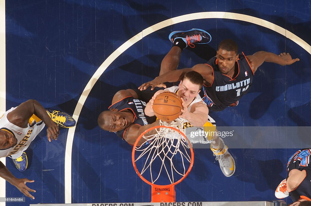 Tyler Hansbrough #50 of the Indiana Pacers dunks against Bismack Biyombo #0 and Michael Kidd-Gilchrist #14 of the Charlotte Bobcats on February 13, 2013 at Bankers Life Fieldhouse in Indianapolis, Indiana.