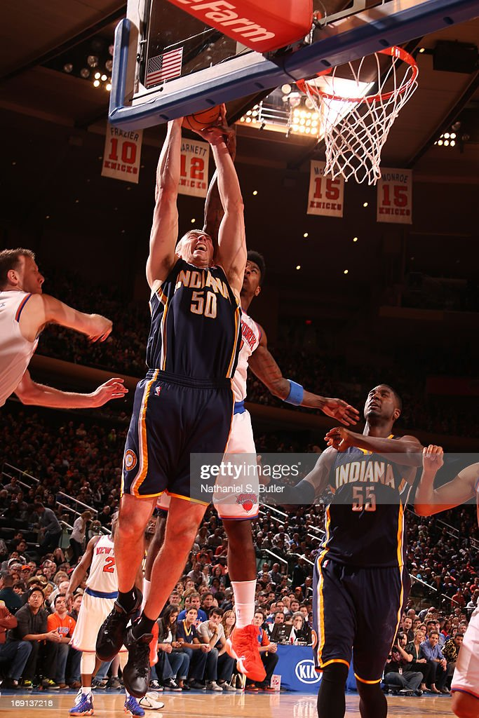 <a gi-track='captionPersonalityLinkClicked' href=/galleries/search?phrase=Tyler+Hansbrough&family=editorial&specificpeople=642794 ng-click='$event.stopPropagation()'>Tyler Hansbrough</a> #50 of the Indiana Pacers dunks against <a gi-track='captionPersonalityLinkClicked' href=/galleries/search?phrase=Iman+Shumpert&family=editorial&specificpeople=5042486 ng-click='$event.stopPropagation()'>Iman Shumpert</a> #21 of the New York Knicks on April 14, 2013 at Madison Square Garden in New York City.