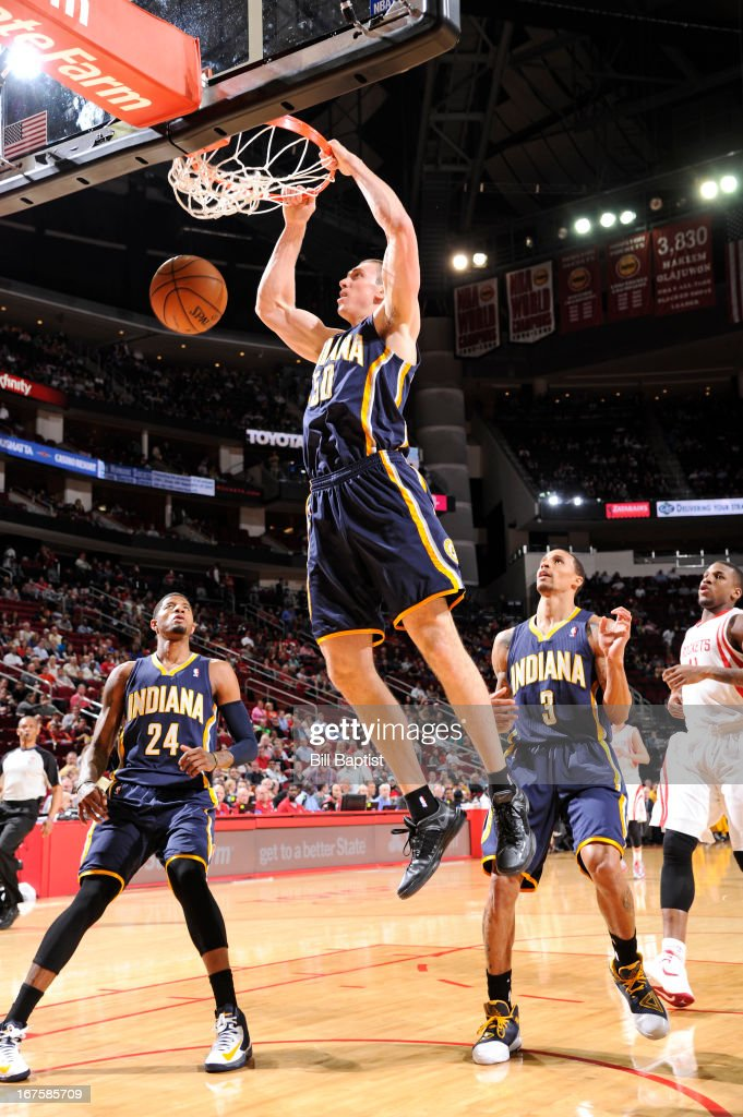 <a gi-track='captionPersonalityLinkClicked' href=/galleries/search?phrase=Tyler+Hansbrough&family=editorial&specificpeople=642794 ng-click='$event.stopPropagation()'>Tyler Hansbrough</a> #50 of the Indiana Pacers dunks against the Houston Rockets on March 27, 2013 at the Toyota Center in Houston, Texas.