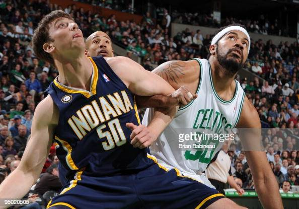 Tyler Hansbrough of the Indiana Pacers gets position under the basket against Rasheed Wallace of the Boston Celtics on December 22 2009 at the TD...