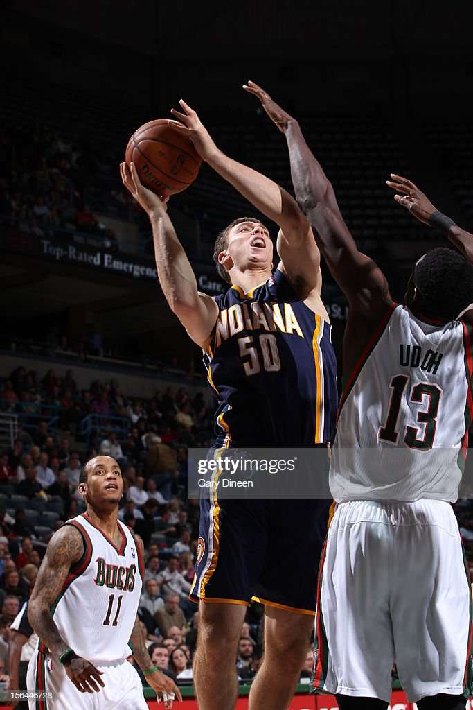 <a gi-track='captionPersonalityLinkClicked' href=/galleries/search?phrase=Tyler+Hansbrough&family=editorial&specificpeople=642794 ng-click='$event.stopPropagation()'>Tyler Hansbrough</a> #50 of the Indiana Pacers goes to the basket against <a gi-track='captionPersonalityLinkClicked' href=/galleries/search?phrase=Ekpe+Udoh&family=editorial&specificpeople=4185351 ng-click='$event.stopPropagation()'>Ekpe Udoh</a> #13 of the Milwaukee Bucks during the NBA game on November 14, 2012 at the BMO Harris Bradley Center in Milwaukee, Wisconsin.