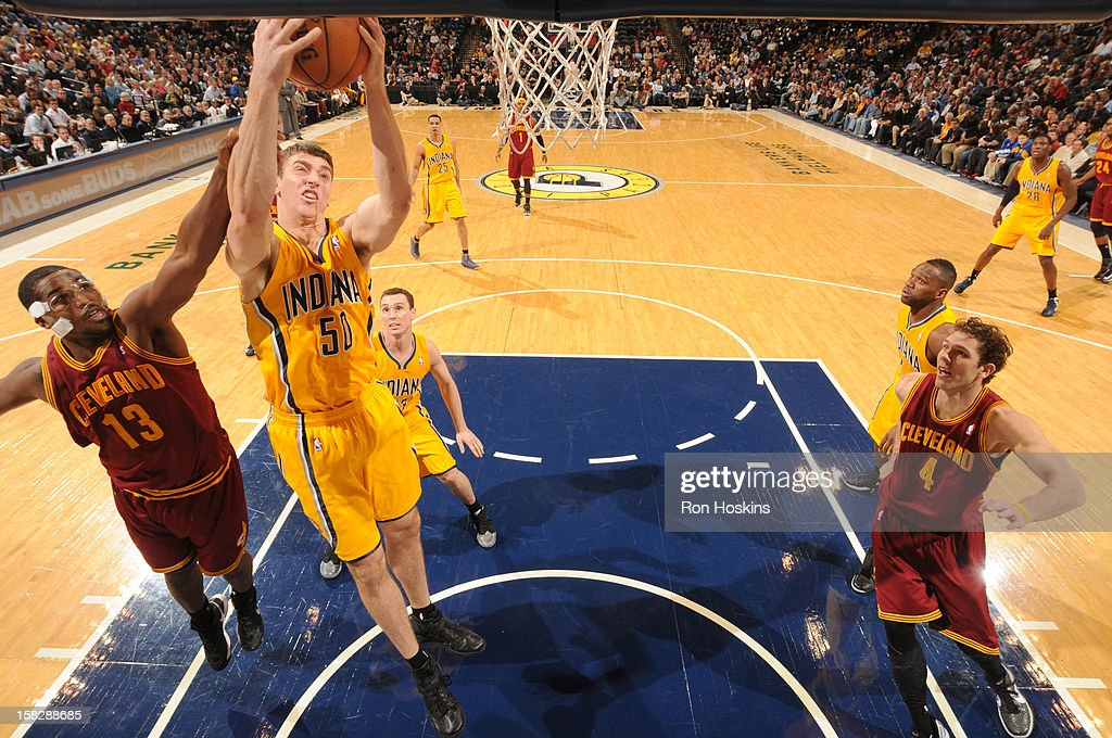 <a gi-track='captionPersonalityLinkClicked' href=/galleries/search?phrase=Tyler+Hansbrough&family=editorial&specificpeople=642794 ng-click='$event.stopPropagation()'>Tyler Hansbrough</a> #50 of the Indiana Pacers goes to the basket against <a gi-track='captionPersonalityLinkClicked' href=/galleries/search?phrase=Tristan+Thompson&family=editorial&specificpeople=5799092 ng-click='$event.stopPropagation()'>Tristan Thompson</a> #13 of the Cleveland Cavaliers during the game between the Indiana Pacers and the Cleveland Cavaliers on December 12, 2012 at Bankers Life Fieldhouse in Indianapolis, Indiana.
