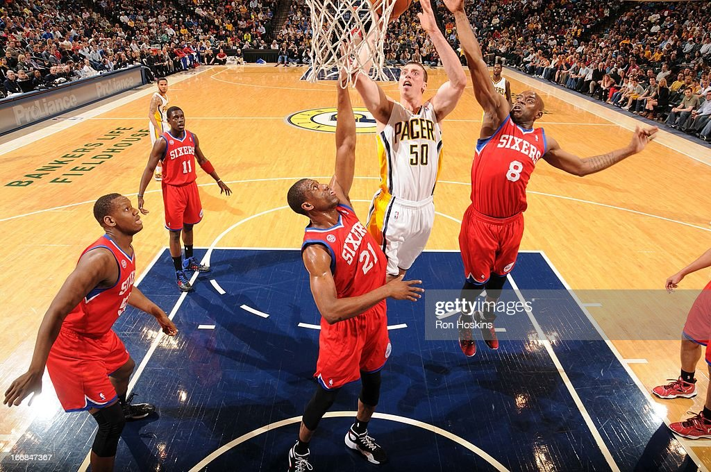 Tyler Hansbrough #50 of the Indiana Pacers goes to the basket against Thaddeus Young #21 of the Philadelphia 76ers and Damien Wilkins #8 of the Philadelphia 76ers during the game between the Indiana Pacers and the Philadelphia 76ers on April 17, 2013 at Bankers Life Fieldhouse in Indianapolis, Indiana.