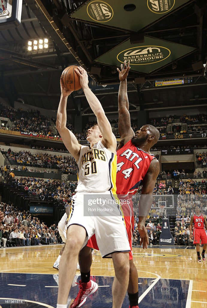 Tyler Hansbrough #50 of the Indiana Pacers goes to the basket against Ivan Johnson #44 of the Atlanta Hawks during the Game Two of the Eastern Conference Quarterfinals between the Indiana Pacers and the Atlanta Hawks on April 24, 2013 at Bankers Life Fieldhouse in Indianapolis, Indiana.