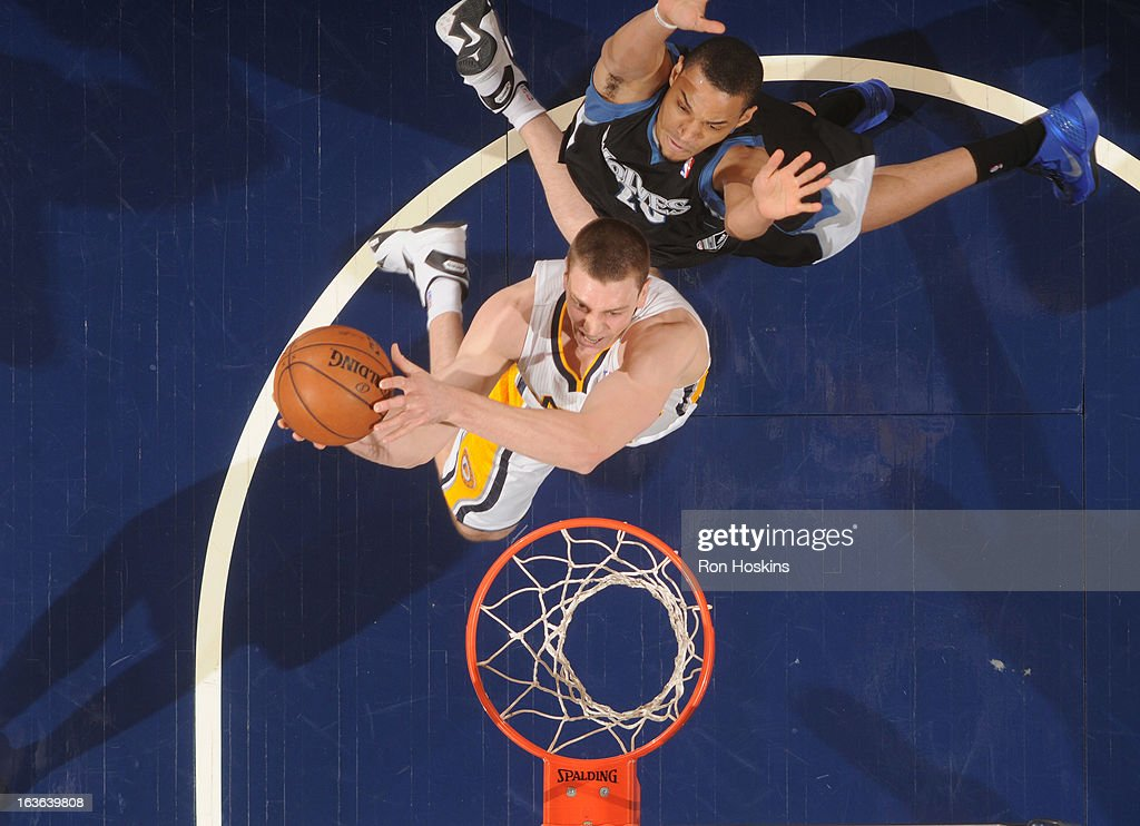 <a gi-track='captionPersonalityLinkClicked' href=/galleries/search?phrase=Tyler+Hansbrough&family=editorial&specificpeople=642794 ng-click='$event.stopPropagation()'>Tyler Hansbrough</a> #50 of the Indiana Pacers goes to the basket under pressure during the game between the Indiana Pacers and the Minnesota Timberwolves on March 13, 2013 at Bankers Life Fieldhouse in Indianapolis, Indiana.
