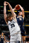 Tyler Hansbrough of the Indiana Pacers goes up for a shot over Marc Gasol of the Memphis Grizzlies during the game on December 18 2009 at FedExForum...