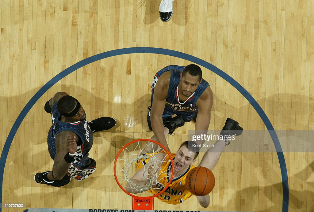 <a gi-track='captionPersonalityLinkClicked' href=/galleries/search?phrase=Tyler+Hansbrough&family=editorial&specificpeople=642794 ng-click='$event.stopPropagation()'>Tyler Hansbrough</a> #50 of the Indiana Pacers grabs a rebound against <a gi-track='captionPersonalityLinkClicked' href=/galleries/search?phrase=Boris+Diaw&family=editorial&specificpeople=201505 ng-click='$event.stopPropagation()'>Boris Diaw</a> #32 of the Charlotte Bobcats on March 23, 2011 at Time Warner Cable Arena in Charlotte, North Carolina.