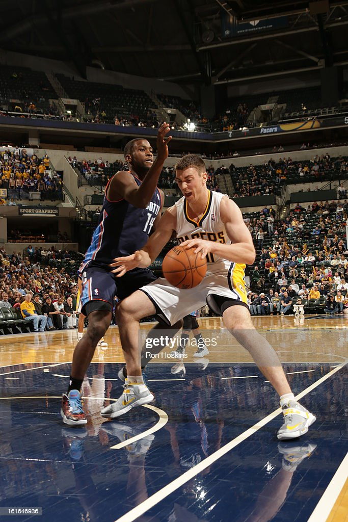 Tyler Hansbrough #50 of the Indiana Pacers handles the ball against Michael Kidd-Gilchrist #14 of the Charlotte Bobcats on February 13, 2013 at Bankers Life Fieldhouse in Indianapolis, Indiana.