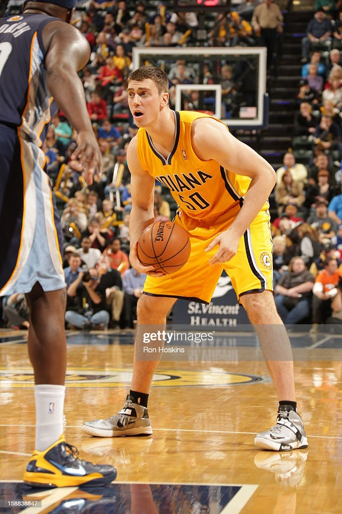 <a gi-track='captionPersonalityLinkClicked' href=/galleries/search?phrase=Tyler+Hansbrough&family=editorial&specificpeople=642794 ng-click='$event.stopPropagation()'>Tyler Hansbrough</a> #50 of the Indiana Pacers looks to drive to the basket against the Memphis Grizzlies on December 31, 2012 at Bankers Life Fieldhouse in Indianapolis, Indiana.