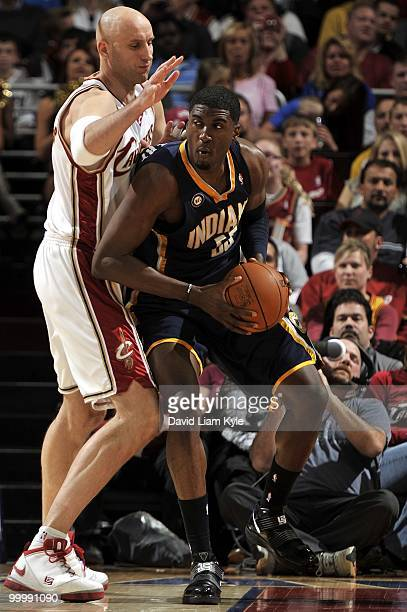 Tyler Hansbrough of the Indiana Pacers looks to move the ball against the Cleveland Cavaliers during the game at Quicken Loans Arena on April 9 2010...