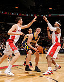 Tyler Hansbrough of the Indiana Pacers looks to shoot against Andrea Bargnani and James Johnson of the Toronto Raptors on March 11 2011 at the Air...