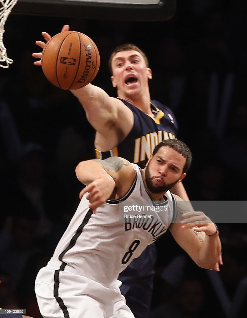 <a gi-track='captionPersonalityLinkClicked' href=/galleries/search?phrase=Tyler+Hansbrough&family=editorial&specificpeople=642794 ng-click='$event.stopPropagation()'>Tyler Hansbrough</a> #50 of the Indiana Pacers punches the ball away from <a gi-track='captionPersonalityLinkClicked' href=/galleries/search?phrase=Deron+Williams&family=editorial&specificpeople=203215 ng-click='$event.stopPropagation()'>Deron Williams</a> #8 of the Brooklyn Nets at the Barclays Center on January 13, 2013 in New York City.