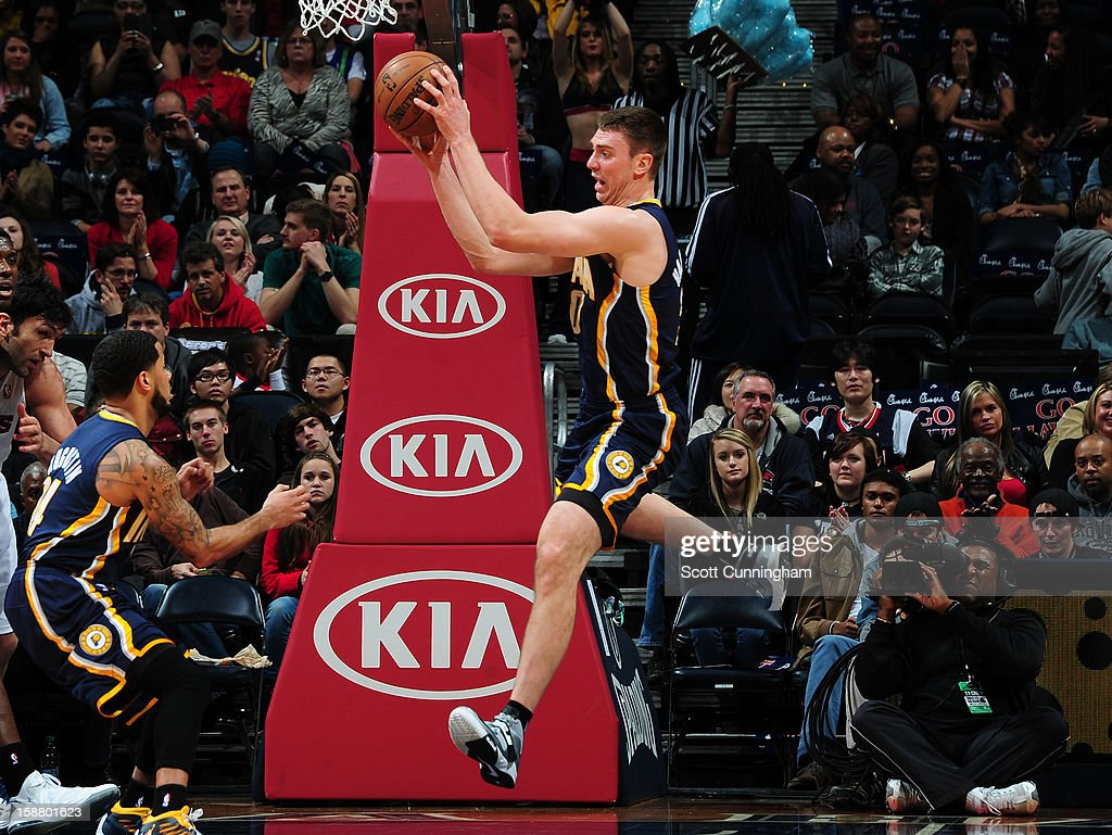 <a gi-track='captionPersonalityLinkClicked' href=/galleries/search?phrase=Tyler+Hansbrough&family=editorial&specificpeople=642794 ng-click='$event.stopPropagation()'>Tyler Hansbrough</a> #50 of the Indiana Pacers rebounds against the Atlanta Hawks on December 29, 2012 at Philips Arena in Atlanta, Georgia.