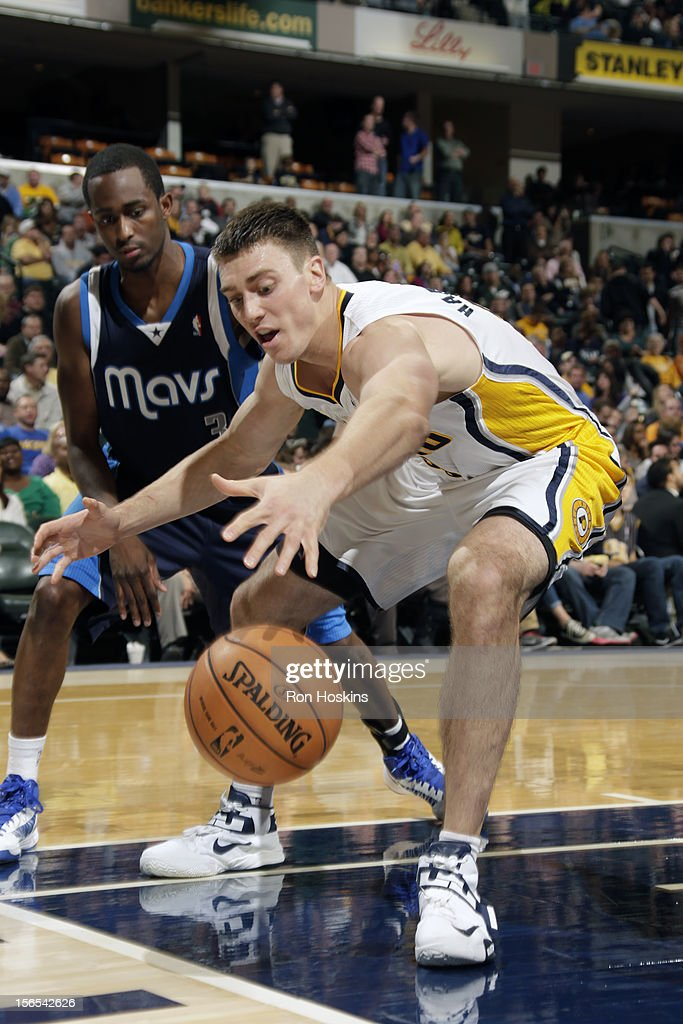 <a gi-track='captionPersonalityLinkClicked' href=/galleries/search?phrase=Tyler+Hansbrough&family=editorial&specificpeople=642794 ng-click='$event.stopPropagation()'>Tyler Hansbrough</a> #50 of the Indiana Pacers saves the ball from going out against the Dallas Mavericks on November 16, 2012 at Bankers Life Fieldhouse in Indianapolis, Indiana.