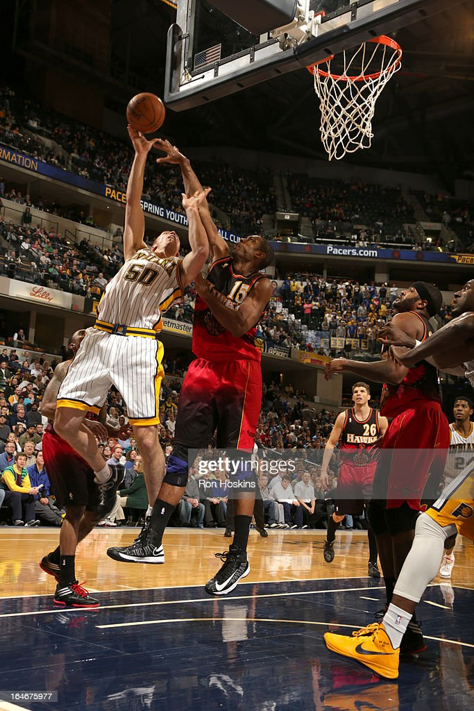 <a gi-track='captionPersonalityLinkClicked' href=/galleries/search?phrase=Tyler+Hansbrough&family=editorial&specificpeople=642794 ng-click='$event.stopPropagation()'>Tyler Hansbrough</a> #50 of the Indiana Pacers shoots against <a gi-track='captionPersonalityLinkClicked' href=/galleries/search?phrase=Al+Horford&family=editorial&specificpeople=699030 ng-click='$event.stopPropagation()'>Al Horford</a> #15 of the Atlanta Hawks on March 25, 2013 at Bankers Life Fieldhouse in Indianapolis, Indiana.
