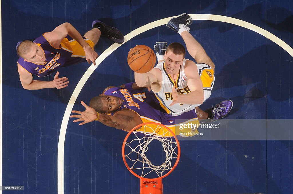 <a gi-track='captionPersonalityLinkClicked' href=/galleries/search?phrase=Tyler+Hansbrough&family=editorial&specificpeople=642794 ng-click='$event.stopPropagation()'>Tyler Hansbrough</a> #50 of the Indiana Pacers shoots against <a gi-track='captionPersonalityLinkClicked' href=/galleries/search?phrase=Antawn+Jamison&family=editorial&specificpeople=201670 ng-click='$event.stopPropagation()'>Antawn Jamison</a> #4 of the Los Angeles Lakers on March 15, 2013 at Bankers Life Fieldhouse in Indianapolis, Indiana.