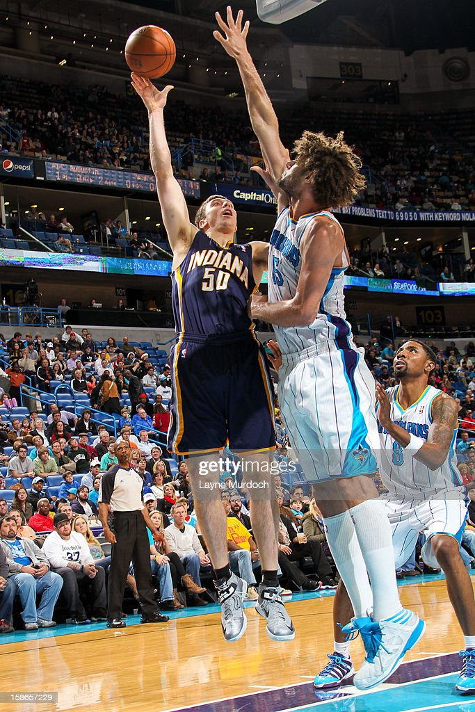 <a gi-track='captionPersonalityLinkClicked' href=/galleries/search?phrase=Tyler+Hansbrough&family=editorial&specificpeople=642794 ng-click='$event.stopPropagation()'>Tyler Hansbrough</a> #50 of the Indiana Pacers shoots against <a gi-track='captionPersonalityLinkClicked' href=/galleries/search?phrase=Robin+Lopez&family=editorial&specificpeople=2351509 ng-click='$event.stopPropagation()'>Robin Lopez</a> #15 of the New Orleans Hornets on December 22, 2012 at the New Orleans Arena in New Orleans, Louisiana.