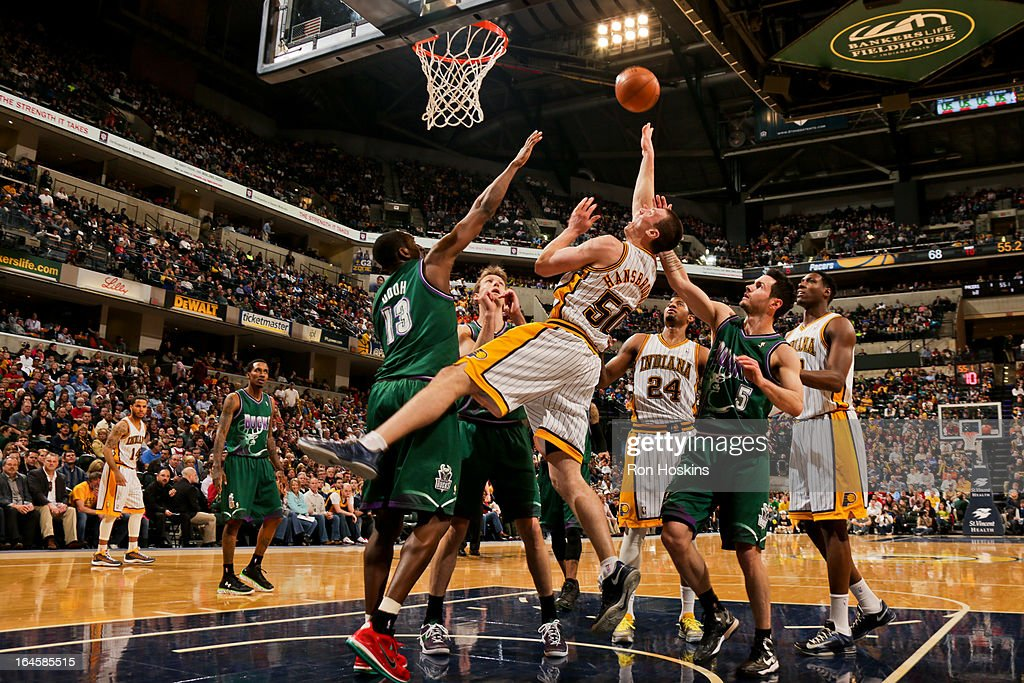 <a gi-track='captionPersonalityLinkClicked' href=/galleries/search?phrase=Tyler+Hansbrough&family=editorial&specificpeople=642794 ng-click='$event.stopPropagation()'>Tyler Hansbrough</a> #50 of the Indiana Pacers shoots in the lane against <a gi-track='captionPersonalityLinkClicked' href=/galleries/search?phrase=Ekpe+Udoh&family=editorial&specificpeople=4185351 ng-click='$event.stopPropagation()'>Ekpe Udoh</a> #13 of the Milwaukee Bucks on March 22, 2013 at Bankers Life Fieldhouse in Indianapolis, Indiana.