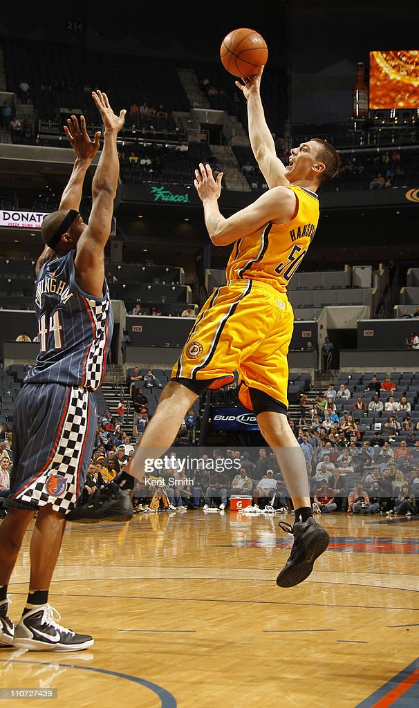 <a gi-track='captionPersonalityLinkClicked' href=/galleries/search?phrase=Tyler+Hansbrough&family=editorial&specificpeople=642794 ng-click='$event.stopPropagation()'>Tyler Hansbrough</a> #50 of the Indiana Pacers shoots over <a gi-track='captionPersonalityLinkClicked' href=/galleries/search?phrase=Dante+Cunningham&family=editorial&specificpeople=683729 ng-click='$event.stopPropagation()'>Dante Cunningham</a> #44 of the Charlotte Bobcats on March 23, 2011 at Time Warner Cable Arena in Charlotte, North Carolina.