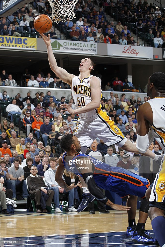 Tyler Hansbrough #50 of the Indiana Pacers shoots over Jared Jeffries #9 of the New York Knicks on March 15, 2011 at Conseco Fieldhouse in Indianapolis, Indiana. The Pacers defeated the Knicks 119-117.