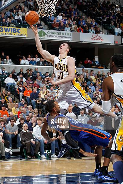 Tyler Hansbrough of the Indiana Pacers shoots over Jared Jeffries of the New York Knicks on March 15 2011 at Conseco Fieldhouse in Indianapolis...