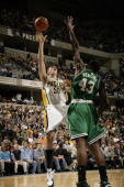 Tyler Hansbrough of the Indiana Pacers shoots over Kendrick Perkins of the Boston Celtics at Conseco Fieldhouse on November 14 2009 in Indianapolis...