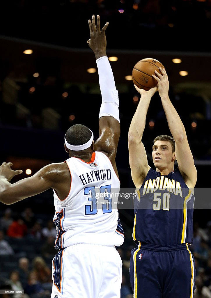 Tyler Hansbrough #50 of the Indiana Pacers shoots the ball over Brendan Haywood #33 of the Charlotte Bobcats during their game at Time Warner Cable Arena on January 15, 2013 in Charlotte, North Carolina.
