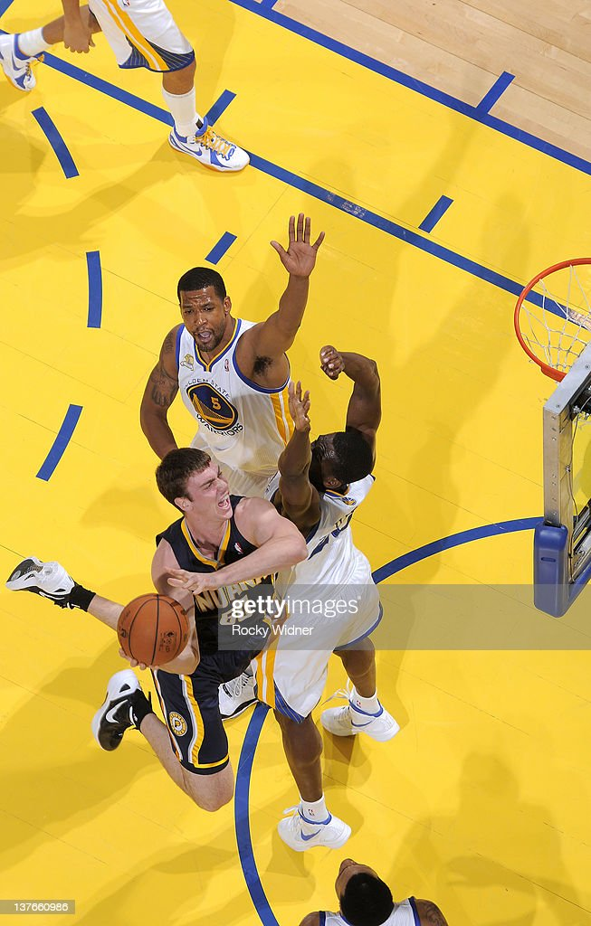 <a gi-track='captionPersonalityLinkClicked' href=/galleries/search?phrase=Tyler+Hansbrough&family=editorial&specificpeople=642794 ng-click='$event.stopPropagation()'>Tyler Hansbrough</a> #50 of the Indiana Pacers shoots the ball over <a gi-track='captionPersonalityLinkClicked' href=/galleries/search?phrase=Ekpe+Udoh&family=editorial&specificpeople=4185351 ng-click='$event.stopPropagation()'>Ekpe Udoh</a> #20 and Dominic McGuire #5 of the Golden State Warriors on January 20, 2012 at Oracle Arena in Oakland, California.