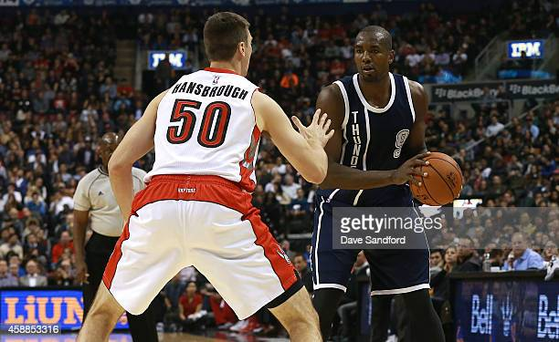 Tyler Hansbrough of the Toronto Raptors defends against Serge Ibaka of the Oklahoma City Thunder during their game at Air Canada Centre on November 4...