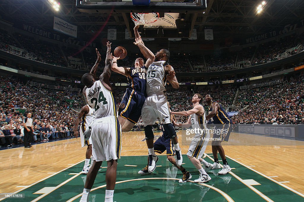 Tyler Hansbrtough #50 of the Indiana Pacers is blocked by <a gi-track='captionPersonalityLinkClicked' href=/galleries/search?phrase=Derrick+Favors&family=editorial&specificpeople=5792014 ng-click='$event.stopPropagation()'>Derrick Favors</a> #15 and Paul Millsap #24 of the Utah Jazz at Energy Solutions Arena on January 26, 2013 in Salt Lake City, Utah.
