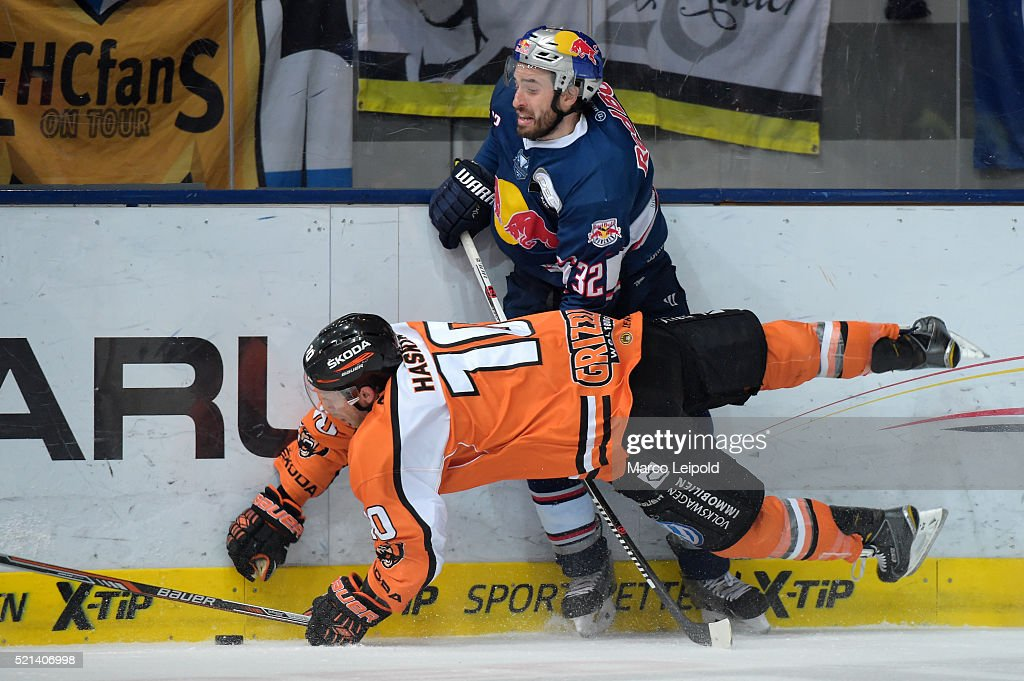 Tyler Haskins of the Grizzlys Wolfsburg and Frederic StDenis of EHC Red Bull Muenchen during the game between the EHC Red Bull Muenchen and the...