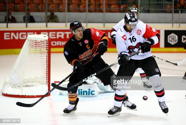 Tyler Haskins of Wolfsburg and Adam Sedlak of Bystrica battle for the puck during the Champions Hockey League match between Grizzlys Wolfsburg and...