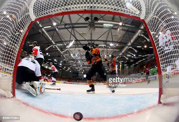 Tyler Haskins of Wolfsburg celebrate the opening goal during the Champions Hockey League match between Grizzlys Wolfsburg and HC05 Banska Bystrica at...