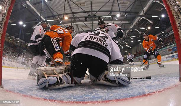 Tyler Haskins of Wolfsburg fails to score over Jochen Reimer goaltender of Nuernberg during the DEL match between Grizzly Adams Wolfsburg and Thomas...