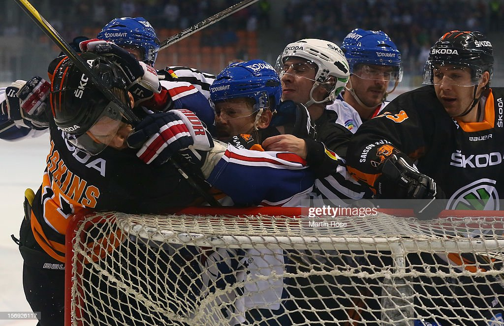 Tyler Haskins (L) of Wolfsburg fights with Ronny Arendt (R) of Mannheim during the DEL match between Wolfsburg Grizzly Adams and Adler Mannheim at Volksbank BraWo EisArena on November 25, 2012 in Wolfsburg, Germany.