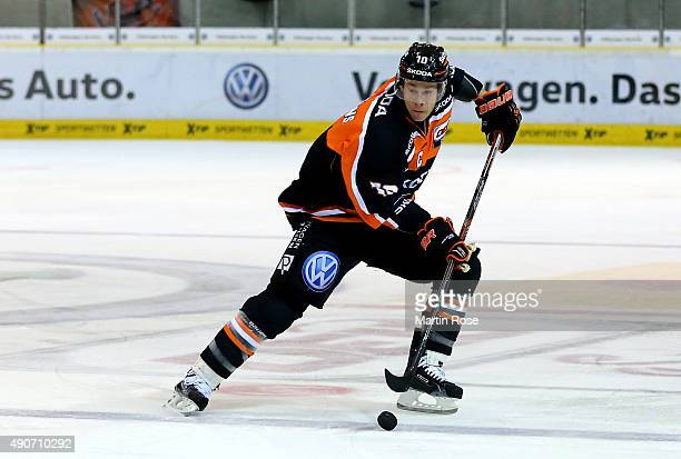 Tyler Haskins of Wolfsburg skates against the EHC Red Bull Muenchen during the DEL match between Grizzly Adams Wolfsburg and EHC Red Bull Muenchenb...