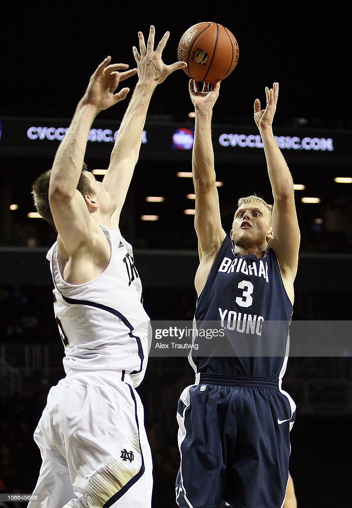 Tyler Haws #3 of the Brigham Young Cougars takes a shot over Jack Cooley #45 of the Notre Dame Fighting Irish during the consolation game of the Coaches Vs. Cancer Classic at the Barclays Center on November 17, 2012 in the Brooklyn borough of New York City.