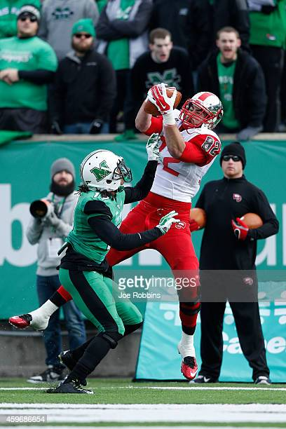 Tyler Higbee of the Western Kentucky Hilltoppers makes an 11yard touchdown reception in the first half of the game against the Marshall Thundering...